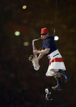 Lee Thompson of Madness performs during the Closing Ceremony at the 2012 Summer Olympics, Sunday, Aug. 12, 2012, in London. (AP Photo/Kristy Wigglesworth)