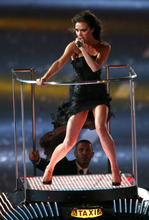 Victoria Beckham (Posh Spice) performs with the Spice Girls during the Closing Ceremony at the 2012 Summer Olympics, Sunday, Aug. 12, 2012, in London. (AP Photo/Sergei Grits)