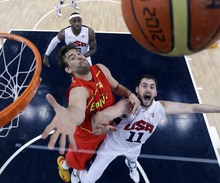 Spain's Marc Gasol, left, and United States' Kevin Love, right, reach for a rebound during the men's gold medal basketball game at the 2012 Summer Olympics, Sunday, Aug. 12, 2012, in London. (AP Photo/Eric Gay, pool)