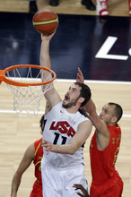 United States' Kevin Love puts up a shot against Spain's Sergio Rodriguez during the men's gold medal basketball game at the 2012 Summer Olympics, Sunday, Aug. 12, 2012, in London. (AP Photo/Victor Caivano)