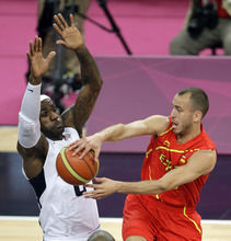Spain's Sergio Rodriguez makes a pass against United States' LeBron James during the men's gold medal basketball game at the 2012 Summer Olympics, Sunday, Aug. 12, 2012, in London. (AP Photo/Matt Slocum)