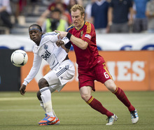 Vancouver Whitecaps' Darren Mattocks, left, of Jamaica, and Real Salt Lake's Nat Borchers vie for the ball during the second half of an MLS soccer game in Vancouver, British Columbia, on Saturday, Aug. 11, 2012. (AP Photo/The Canadian Press, Darryl Dyck)