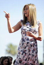 Actress Jennifer Aniston gestures to the crowd during a ceremony to award her a new star on the Hollywood Walk of Fame in Los Angeles, Wednesday, Feb. 23, 2012. (AP Photo/Chris Pizzello)