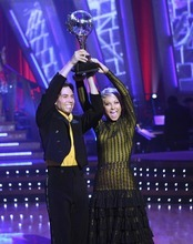 FILE - This May 22, 2007 file photo released by ABC shows Olympic gold medal-winning speed skater Apolo Anton Ohno , left, who was crowned champion and awarded the mirror ball trophy with his professional partner, Julianne Hough , on the season finale of