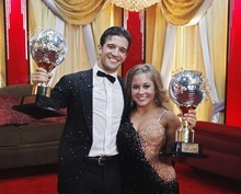 In this May, 19, 2009 file photo released by ABC, Shawn Johnson and her professional partner, Mark Ballas, hold their trophies during Dancing with the Stars finale show in Los Angeles. ABC says an