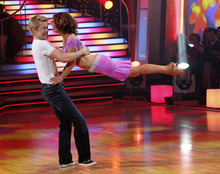 In this publicity image released by ABC, Jennifer Grey, right, and her partner Derek Hough perform on the celebrity dance competition series,