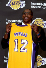 Dwight Howard, newly acquired by the Los Angeles Lakers from the Orlando Magic, holds his jersey during a team NBA basketball news conference, Friday, Aug. 10, 2012, in El Segundo, Calif. (AP Photo/Los Angeles Times, Anne Cusack)