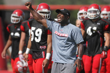 Lennie Mahler  |  The Salt Lake Tribune Utah cornerbacks coach Sharrieff Shah celebrates defensive performance in a practice scrimmage Saturday, Aug. 11, 2012.