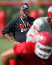 Lennie Mahler  |  The Salt Lake Tribune Utah head coach Kyle Whittingham watches the football team's practice scrimmage Saturday, Aug. 11, 2012.
