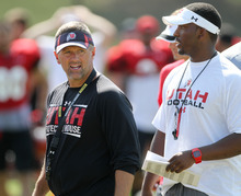 Lennie Mahler  |  The Salt Lake Tribune Utah head coach Kyle Whittingham and QB coach Brian Johnson watch the team's practice scrimmage Saturday, Aug. 11, 2012.