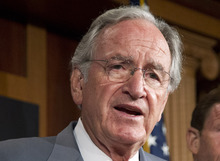 FILE - In this July 24, 2012 file photo, Sen. Tom Harkin, D-Iowa speaks during a news conference on Capitol Hill in Washington. It's not just the Pentagon and defense contractors that face a funding crisis from broad government spending cuts in January. Domestic programs are on the chopping block too, in ways that could affect average Americans more. Fewer air traffic controllers, border guards, FBI agents and park rangers would be on the job as furloughs sweep across the government. Less meat might get inspected, and fewer people would get winter heating subsidies  (AP Photo/Manuel Balce Ceneta, File)
