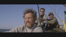 Richard Dreyfuss, Roy Scheider, and Robert Shaw, battle a man-eating shark in the classic 1975 blockbuster,