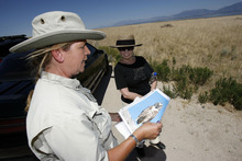 Francisco Kjolseth  |  The Salt Lake Tribune Park ranger Ellen Labotka gets a captive audience in Bonnie Mcfarlane of Ogden as she talks about the Burrowing Owl while teaching about some of the many island resources on Antelope Island State Park and why and how they are cared for including the peregrine falcon, historic mulberry grove, fresh water springs, Least Chub fish and wheat fields.