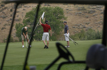 Scott Sommerdorf  |  The Salt Lake Tribune              A threesome plays golf at Mountain Dell Golf Course, Monday, August 13, 2012.