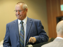 Al Hartmann  |  The Salt Lake Tribune   Stephen McCaughey, defense lawyer for Roberto Roman, enters Fourth District Court in Spanish Fork on Monday, Aug. 13 for jury selection.     Roman is accused of killing Millard County Deputy Josie Greathouse Fox.