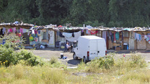 FILE - This is a Friday Aug. 10, 2012. file photo of  a Roma encampment is set up near a highway in Clamart, west of Paris,  Police officers on Thursday shut down encampments used by Roma or Gypsies, in Paris and in the northern city of Villeneuve d'Ascq.  The Gypsy camps lack electricity and running water. Grocery carts become makeshift grills. Rats run rampant and fleas gnaw on young and old alike. It's a life that modernity has bypassed, compounded by a dismal economy that has stretched from their homeland in Romania to a France that wants them to go somewhere  anywhere  else.(AP Photo/Michel Euler, File)
