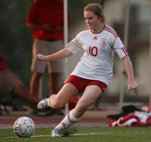 Steve Griffin | The Salt Lake Tribune   Judge's Madison Ulibarri centers the ball during soccer game between Judge and Highland at Judge Memorial Catholic High School in Salt Lake City, Utah Tuesday August 14, 2012.