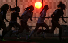 Steve Griffin | The Salt Lake Tribune   The sun glows on the horizon during soccer game between Judge and Highland at Judge Memorial Catholic High School in Salt Lake City, Utah Tuesday August 14, 2012.