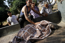 Syrians injured in an air strike that hit their homes evacuate a field hospital after a second air strike in the town of Azaz on the outskirts of Aleppo, Syria, Wednesday, Aug. 15, 2012. (AP Photo/Khalil Hamra)