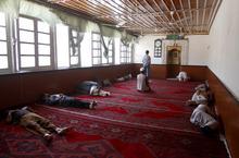 Afghan Muslim men sleep in a mosque as they wait to break their fast in Kabul, Afghanistan, Thursday, Aug. 16, 2012. (AP Photo/Ahmad Jamshid)