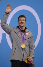 Ryan Lochte waves to the crowd after receiving his Gold Medal after winning the Men's 400m Individual Medley  during the evening session of the swimming competition Saturday, July 28, 2012 at the Aquatics Centre.  John Leyba, The Denver Post