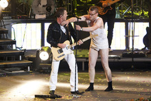 A desperate -- and stoned -- Frank (Frank Hvam, right) invades the stage during a rock show in the raunchy Danish comedy