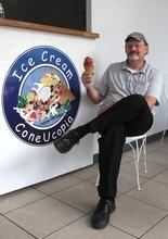 Rick Egan  | The Salt Lake Tribune   Shawn Stuart holds a waffle cone at Ice Cream ConeUcopia at 26 E. 600 South, Salt Lake City.