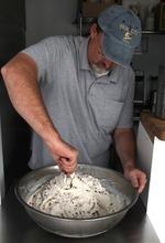 Rick Egan  | The Salt Lake Tribune   Shawn Stuart stirs nuts and chocolate chips into a batch of ice cream at his shop, Ice Cream ConeUcopia, 26 E. 600 South, Salt Lake City.