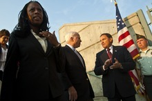 Chris Detrick  |  The Salt Lake Tribune Mia Love, Sen. John McCain and Utah Governor Gary R. Herber talk during a rally for Mia Love at the Utah Cultural Celebration Center Thursday August 16, 2012.  John McCain spoke Thursday evening to a crowd of about 250 at a rally for the Love campaign, part of a swing through Western states by the 2008 Republican presidential nominee. Love is squaring off against Democratic Rep. Jim Matheson in the state's new 4th District Congressional District.
