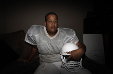 Twelve-year-old Elijah Earnheart posses for a photo at his home in Mesquite, Texas, Thursday, Aug. 16, 2012. The 6-foot, 300-pound 12-year-old has been ruled ineligible to play Pee Wee football in the Dallas area. Despite being a young seventh-grader, officials say is more than twice the maximum allowable Pee Wee weight of 135 pounds. (AP Photo/LM Otero)