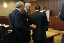 Scott Sommerdorf  |  The Salt Lake Tribune              Attorney Jeremy Delcino speaks with client Roberto Miramontes Román just before they left court after the jury was excused to deliberate on the verdict, Friday, August 17, 2012.