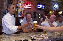 Carolyn Kaster  |  The Associated Press President Barack Obama stops for a beer at The Pump House, a pub and grill, Tuesday, Aug. 14, 2012, in Cedar Falls, during a three-day campaign bus tour through Iowa.