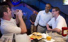 Carolyn Kaster  |  The Associated Press President Barack Obama visits with patrons as he stops at The Pump House, a pub and grill, Tuesday, Aug. 14, 2012, in Cedar Falls, during a three-day campaign bus tour through Iowa.