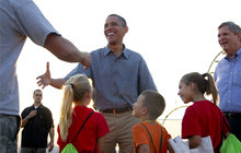 President Barack Obama and  Agriculture Secretary Tom Vilsack visit with people at the Iowa State Fair, Monday, Aug. 13, 2012, in Des Moines, Iowa,  during a three day campaign bus tour through Iowa. (AP Photo/Carolyn Kaster)