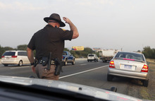 Al Hartmann  |  The Salt Lake Tribune   Trooper Emery Calkins heads out to write a warning to another motorist violating Utah's express-lane laws. During a three-day enforcement blitz that ran through Thursday, troopers wrote warnings to educate drivers.