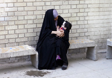 Umm Ahmed holds her injured one-year old son, Ahmed, at a hospital after a car bomb attack in Baghdad, Iraq, Friday, Aug. 17, 2012. Iraqi officials said Friday that a blistering string of attacks across the country the previous day ultimately killed at least 93 people, as the extent of the violence grew clearer and mourners started to bury their dead.(AP Photo/Karim Kadim)
