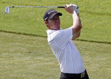 Jimmy Walker hits from the ninth fairway  during the second round of the Wyndham Championship golf tournament in Greensboro, N.C., Friday, Aug. 17, 2012. (AP Photo/Gerry Broome)