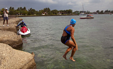 U.S. swimmer Diana Nyad jumps into the water to start her swim to Florida from Havana, Cuba, Saturday, Aug. 18, 2012. Endurance athlete Nyad launched another bid Saturday to set an open-water record by swimming from Havana to the Florida Keys without a protective shark cage. (AP Photo/Ramon Espinosa)