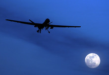 FILE - In this Jan. 31, 2010 file photo, an unmanned U.S. Predator drone flies over Kandahar Air Field, southern Afghanistan, on a moon-lit night. A missile launched from a U.S. drone struck a suspected militant hideout in a tribal region in northern Pakistan where allies of a powerful warlord were gathered Saturday, Aug. 18, 2012, killing five of his supporters, Pakistani officials said. (AP Photo/Kirsty Wigglesworth, File)