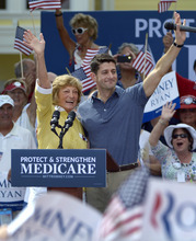 Republican vice-presidential candidate Rep. Paul Ryan, R-Wis., center left, and his mother Betty Ryan Douglas wave to supporters at a campaign rally in The Villages, Fla., Saturday, Aug. 18, 2012.  (AP Photo/Phelan M. Ebenhack)