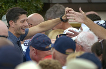 Republican vice-presidential candidate Rep. Paul Ryan, R-Wis., left, works the crowd after campaigning at The Villages, Fla., Saturday, Aug. 18, 2012.  (AP Photo/Phelan M. Ebenhack)