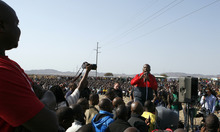 Expelled ruling party youth league president Julius Malema address mine workers at the Lonmin mine near Rustenburg, South Africa, Saturday, Aug. 18, 2012. South African police on Thursday, opened fire killing 34,on a crowd of striking workers at a platinum mine. (AP Photo/Themba Hadebe)