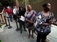 Sheila Bird, right, waits in line for employment interviews at a job fair at City Target in Los Angeles, Friday, Aug.  17 2012.  The seasonally adjusted unemployment rate in Los Angeles County remained unchanged at 11.2 percent in July compared with June, the state Employment Development Department announced Friday. (AP Photo/Nick Ut)