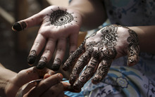 A Pakistani girl gets her hands painted with henna in preparation for the upcoming Eid al-Fitr festival, in Karachi, Pakistan, Saturday, Aug. 18, 2012. Eid al-Fitr marks the end of the holy month of Ramadan. (AP Photo/Fareed Khan)