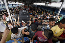 Indians originally from the northeastern states crowd as they disembark from a train originating in the southern city of Bangalore, in Gauhati, Assam state, India, Saturday, Aug. 18, 2012. Thousands of Indians from the northeast are leaving the southern city of Bangalore and other towns, spurred by rumors they would be attacked in retaliation for communal violence in their home state of Assam. (AP Photo/Anupam Nath)