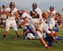 Trent Nelson  |  The Salt Lake Tribune Jordan quarterback Austin Kafentzis runs for a second quarter touchdown as Fremont hosts Jordan High School football in Ogden, Utah Friday, August 17, 2012.