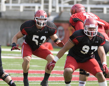 Paul Fraughton | The Salt Lake Tribune Linebacker Jason Whittingham (53) and  defensive end Johnny Mahe (97) practice at Tuesday's scrimmage.