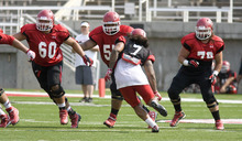 Paul Fraughton | The Salt Lake Tribune Offensive linemen Siaosi Alono (60), Hiva Lutui (55) and Percy Tamoelau (79) practice at the Ute scrimmage on Tuesday.