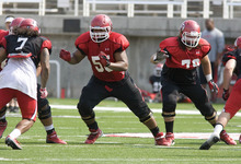Paul Fraughton | The Salt Lake Tribune Offensive linemen Hiva Lutui (55) and Percy Tamoelau (79) practice at the Ute scrimmage on Tuesday.
