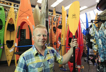 Carlos Osorio     The Associated Press Andy Schepper is vice president of Summit Sports in Keego Harbor, Mich., which sells kayaks. With plants shriveling up and outdoorsy types feeling it's too hot to be active in the extreme summer heat, many small business owners with seasonal businesses aren't ringing up a lot of sales.